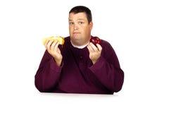 Homem que pensa que comer Foto de Stock Royalty Free