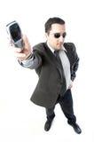 Homem que prende o telefone móvel Fotos de Stock