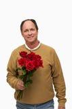 Homem que prende rosas vermelhas Imagem de Stock