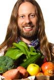 Homem que prende um saco da fruta e verdura fresca Imagens de Stock