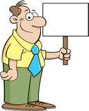 Homem que prende um sinal Fotografia de Stock