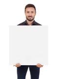 Homem que prende um sinal em branco Fotografia de Stock