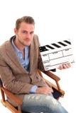 Homem que prende uma ardósia da película imagens de stock royalty free