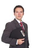 Homem que prende uma prancheta Foto de Stock