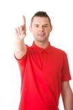 Homem que pressiona um botão abstrato do écran sensível Fotografia de Stock