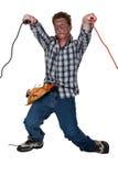 Homem que recebe choque eléctrico fotos de stock