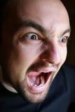 Homem que screming foto de stock