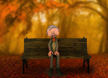 Homem que senta-se apenas no banco Fotos de Stock Royalty Free