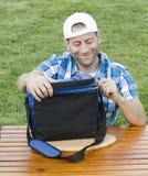 Homem que senta-se na grama Imagens de Stock Royalty Free
