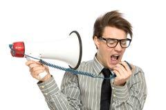 Homem que Shouting através do megafone fotos de stock royalty free