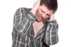 Homem que sofre da dor de cabeça fotos de stock