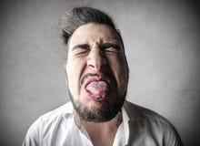 Homem que stucking sua língua para fora Imagem de Stock Royalty Free