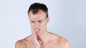 Homem que tem o toothache Fotografia de Stock Royalty Free