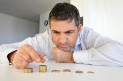 Homem que tem problemas financeiros Foto de Stock Royalty Free