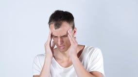 Homem que tem uma dor de cabeça Fotos de Stock Royalty Free