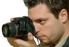 Homem que toma a fotografia foto de stock