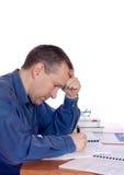 Homem em sua mesa Fotos de Stock