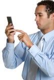 Homem que usa a calculadora Fotografia de Stock