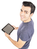 Homem que usa o tablet pc ou o iPad Fotografia de Stock