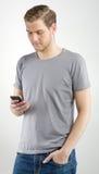Homem que usa Smartphone Imagens de Stock Royalty Free