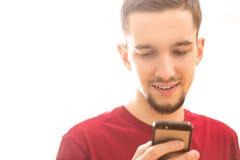 Homem que usa Smartphone Fotografia de Stock Royalty Free