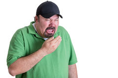 Homem que veste espirrar verde da camisa fotografia de stock royalty free