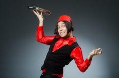 Homem que veste o chapéu vermelho do fez Fotografia de Stock