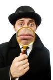 Homem que veste o revestimento preto isolado no branco Fotografia de Stock