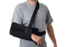 Homem que veste uma cinta do braço Fotos de Stock Royalty Free