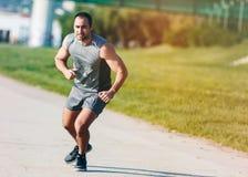 Homem Running do esporte imagem de stock
