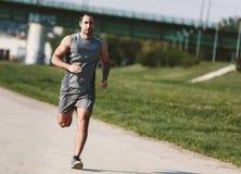 Homem Running do esporte fotografia de stock