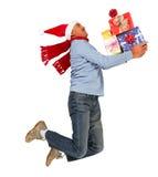 Homem running feliz com presentes do Xmas fotografia de stock