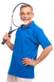 Homem sênior com uma raquete de tênis Foto de Stock