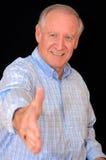 Homem sênior do aperto de mão fotografia de stock