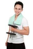 Homem saudável dos esportes com sorriso do dumbbell Fotografia de Stock Royalty Free