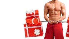 Homem 'sexy' de Santa Claus com um barbell imagem de stock