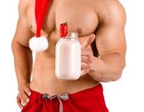 Homem 'sexy' do Natal que levanta na câmera isolada em um fundo branco Imagens de Stock Royalty Free