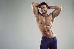 Homem 'sexy' no estúdio fotografia de stock royalty free