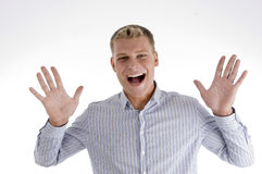 Homem Shouting que mostra suas palmas Fotografia de Stock Royalty Free