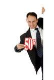 Homem, sinal de um disconto de cinqüênta por cento Fotografia de Stock