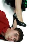 Homem sob o polegar Imagem de Stock