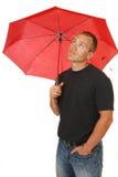 Homem sob um guarda-chuva fotografia de stock