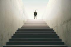 Homem sobre as escadas fotografia de stock