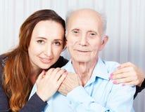 Homem superior com seu cuidador em casa Imagem de Stock Royalty Free