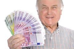 Homem superior de sorriso com um punhado do dinheiro Fotos de Stock