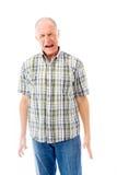Homem superior que grita na frustração isolada no fundo branco Fotografia de Stock