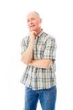 Homem superior que sorri com mão no queixo Imagem de Stock