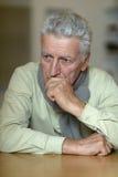 Homem superior triste em casa Fotografia de Stock Royalty Free