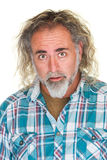 Homem surpreendido com cabelo longo Fotos de Stock