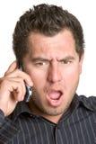 Homem surpreendido do telefone imagens de stock royalty free